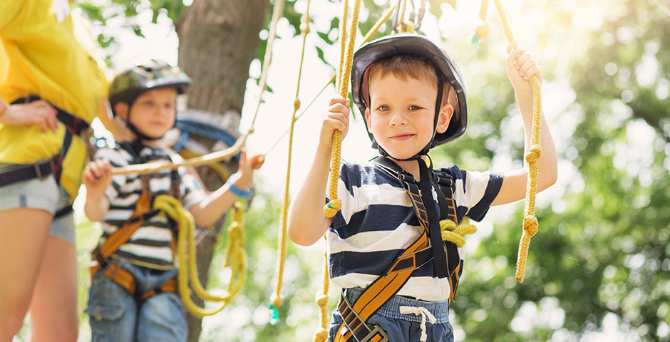Kids in climbing harness